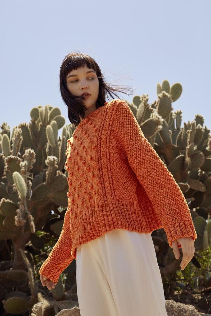 27 Oranssi naisen neulepusero