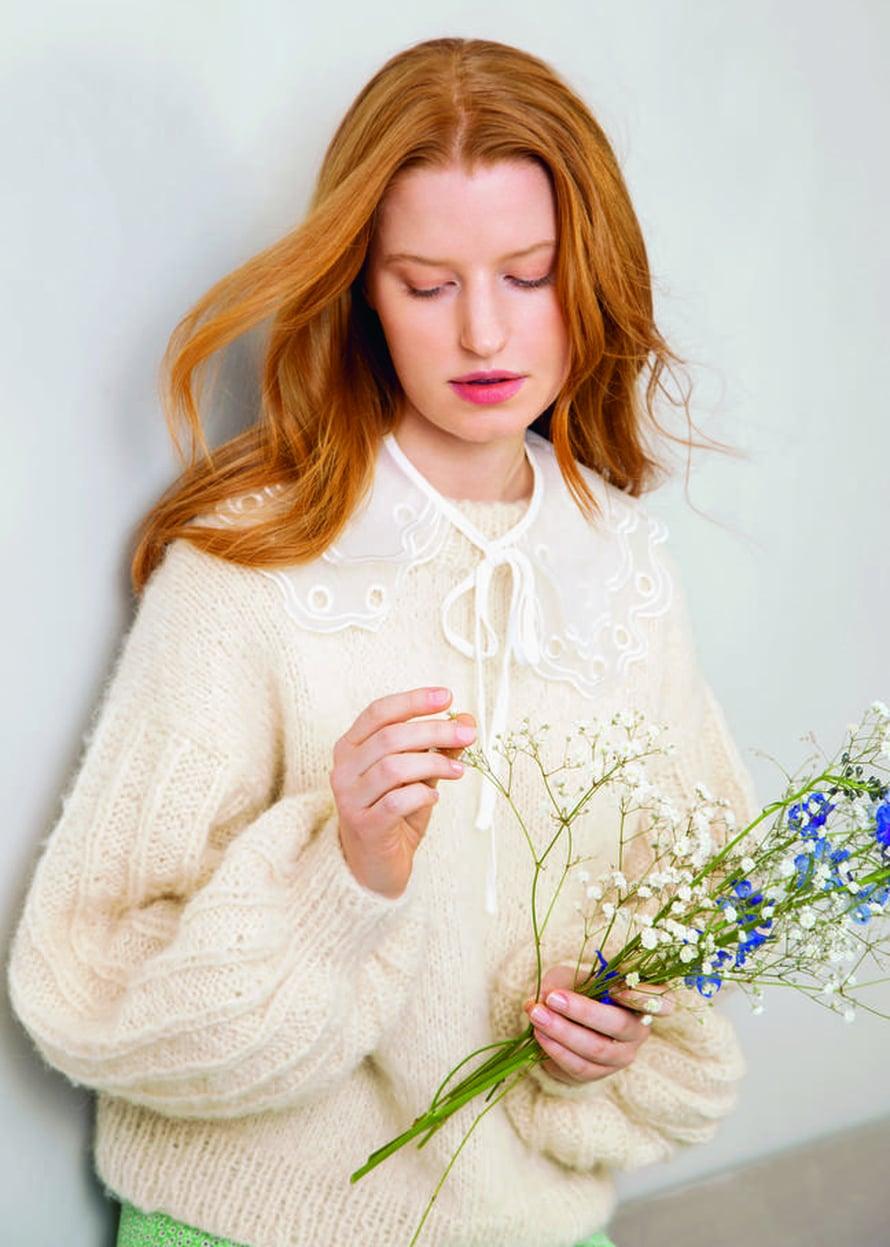 19 Valkoinen villatakki