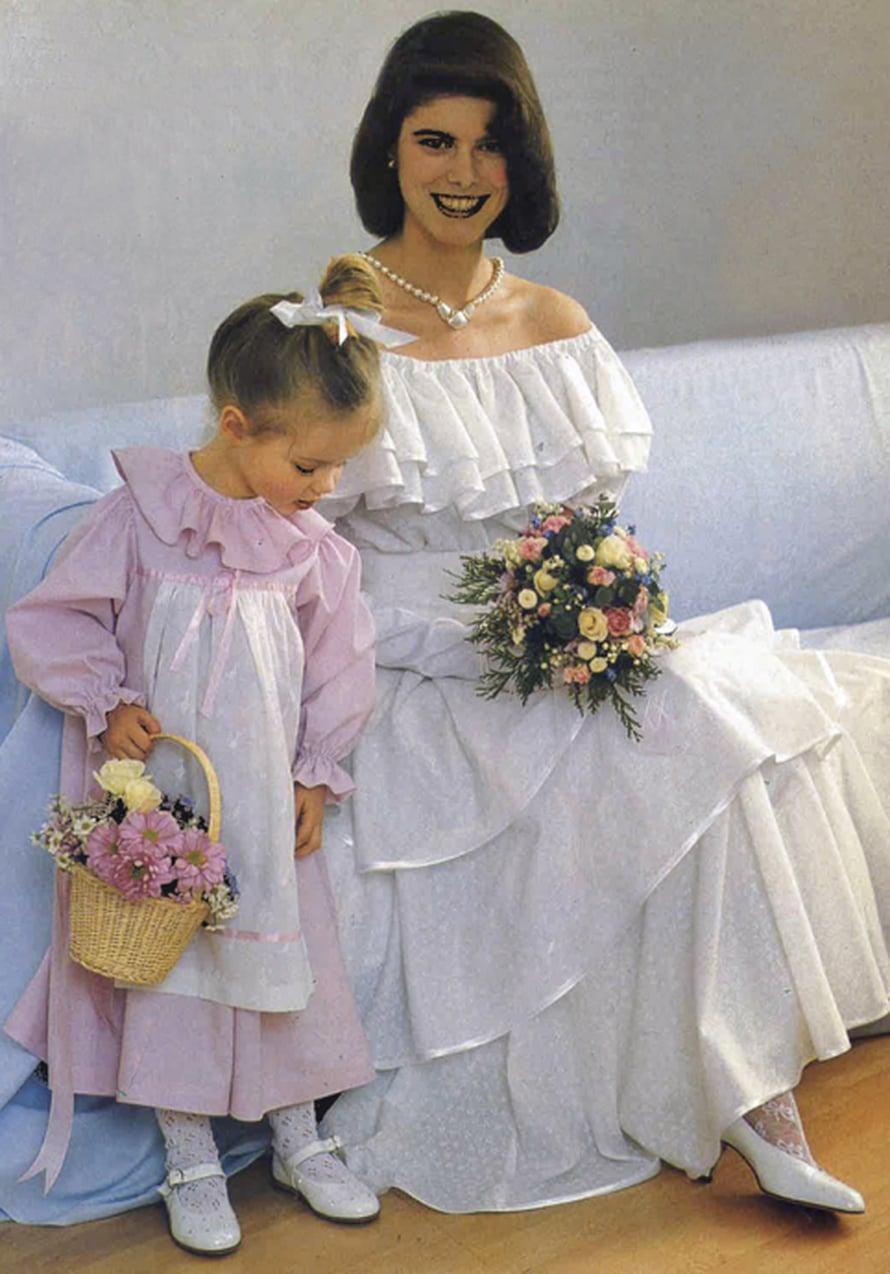 Vuoden 1989 juhannusmorsian pukeutui ilmavasti olkapäät paljastavaan batistipukuun. Mustasta kankaasta ommeltuna malli muuttuu espanjalaistyyliseksi iltapuvuksi.
